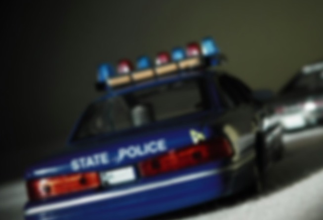blurry police car pulled over drunk driver